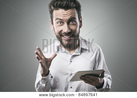 Joyful Man Using His Tablet