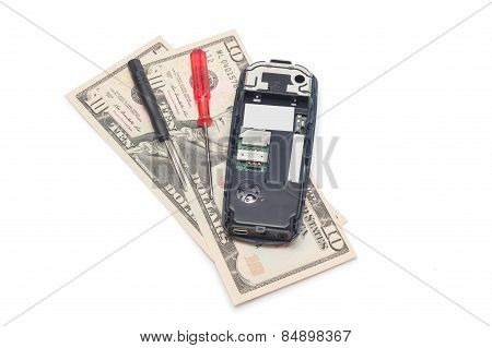 Broken Mobile Phone And Dollars Isolated On White Background