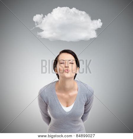 Beautiful lady blows a kiss, isolated on grey background with cloud