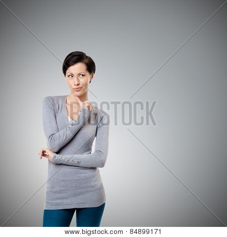Intriguing look, isolated on grey background