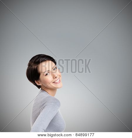 Smiley joyful woman, on grey background