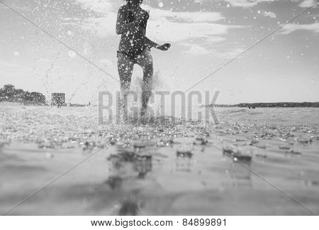 young woman running on the water
