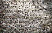 stock photo of mesopotamia  - Ancient Assyrian wall carvings of cuneiform writing - JPG