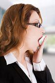 picture of sleepy  - Tired sleepy beautiful businesswoman yawning - JPG