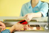 pic of cashiers  - Teller window with working cashier  - JPG