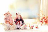 stock photo of rag-doll  - Handmade dolls near window close - JPG