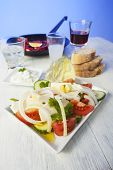 stock photo of ouzo  - greek salad with florini peppers on white wood - JPG