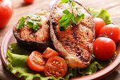 image of plate fish food  - Tasty baked fish on plate on table close - JPG
