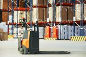 pic of food truck  - Manual forklift pallet stacker truck equipment at food warehouse - JPG