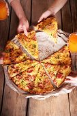 picture of take out pizza  - Friends hands taking slices of pizza - JPG
