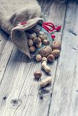 stock photo of ground nut  - a bag full of nuts and almonds - close up