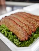 image of brisket  - BBQ beef brisket on a bed of parsley  - JPG