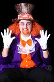 stock photo of mad hatter  - Man dressed in halloween costume with orange hair - JPG