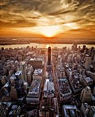 stock photo of vivid  - Vivid sunset over New York taken from the Empire State Building - JPG