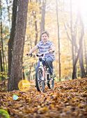 image of bike path  - Young boy with bike on path during the autumn - JPG