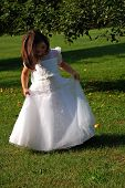 stock photo of flower girl  - Four year old flower girl dancing outside - JPG
