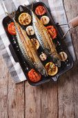 stock photo of grill  - Grilled mackerel fish and vegetables in a pan grill - JPG