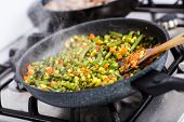 picture of chinese wok  - Stir fry vegetables in a wok cooking on the stove with selective focus - JPG