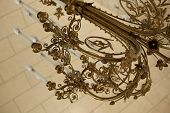 pic of copper  - Close up of a stylish copper chandelier in a house - JPG