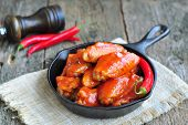 image of saucepan  - Hot Chicken Wings Barbecue in Black Saucepan isolated - JPG