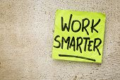 picture of productivity  - work smarter reminder on a green sticky note against rustic barn wood p productivity concept - JPG