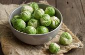 image of brussels sprouts  - Brussels sprouts in a bowl on an old wooden table - JPG