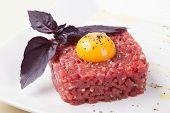 foto of yolk  - tartar of beef with egg yolk - JPG