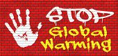 stock photo of global-warming  - stop global warming and climate change carbon neutral go green energy solar or wind power  green house effect no pollution graffiti on red brick wall - JPG