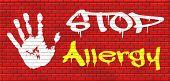 stock photo of allergy  - Allergy stop allergies and allergic reactions hypersensitivity disorder of the immune system  asthma attack caused by food or pollen hay fever graffiti on red brick wall - JPG