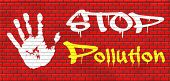 stock photo of reuse  - stop pollution reuse and recycle go green renewable energy and sustainable agriculture reduce waste graffiti on red brick wall - JPG