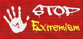 pic of extremist  - stop extremism political and religion extreme left and right jew catholic and muslim stop terrorism no discrimination graffiti on red brick wall - JPG
