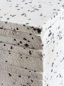 stock photo of insulator  - Pack of insulation styrofoam panels with graphite additive - JPG
