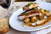 foto of red shallot  - Piece of veal potatoes and shallots on a plate - JPG