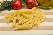 picture of pasta  - Raw penne pasta on the wood background - JPG
