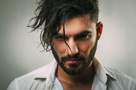 image of wet  - Portrait of a man with a beard and wet face - JPG