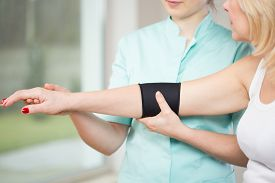 stock photo of elbow  - Image of patient after injury using elbow stabilizer  - JPG