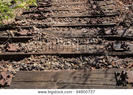 old railway, railroad, rail track , abandoned, destroyed and overgrown wood