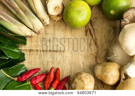 Thai Food Ingredients Is Lime, Mushroom, Pepper, Galangal,   Bergamot Leaves, Lemon Grass On Wooden