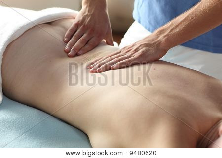 female receiving back massage - close up