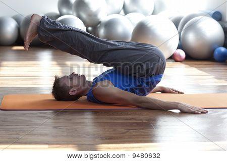 man practicing pilates