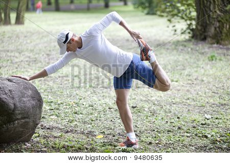 man   stretching before running in a park