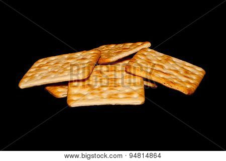 Crackers On Black Background
