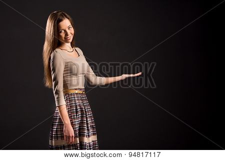 Photo of a pretty sensual girl showing product on her palm