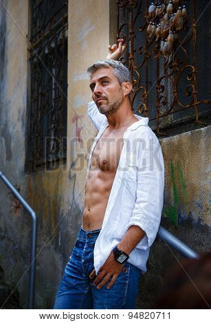 Sexy Fashion Portrait Hot Male Model In Stylish Jeans And Shirt With Muscular Body Posing. And Dream