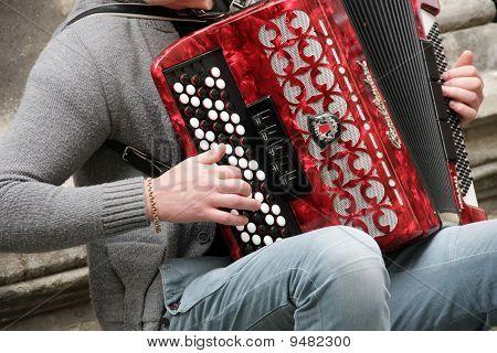musician plays the bayan