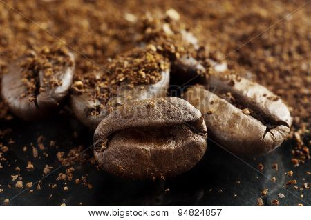 Closeup Shot Of Coffee Powder And Beans On Black