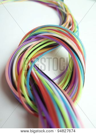 Background With A Beautiful Knot Of Multicolored Strings