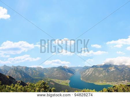 Mountainous Landscape And Blue Sky Background With Clouds