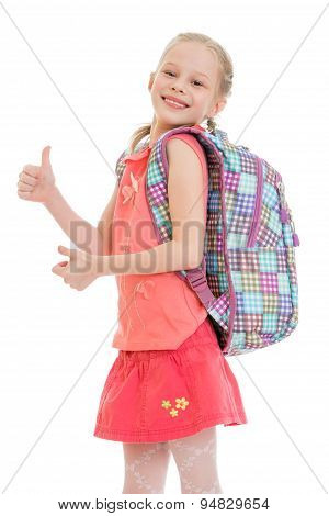 Cheerful little girl with a backpack,