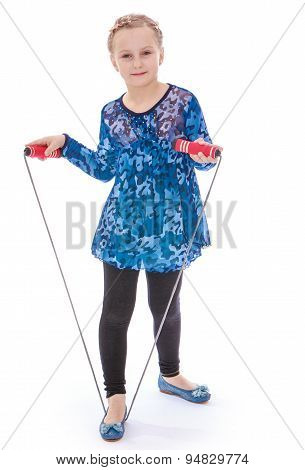 Cute cheerful girl with a yellow skipping rope in your hands